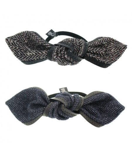 py57-boucle-knot-trimmed-with-leather-pony